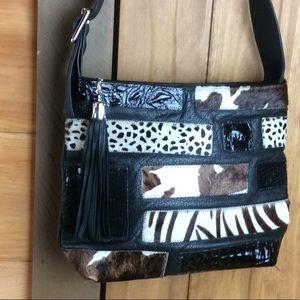 Mina black leather handbag with calf hair accents